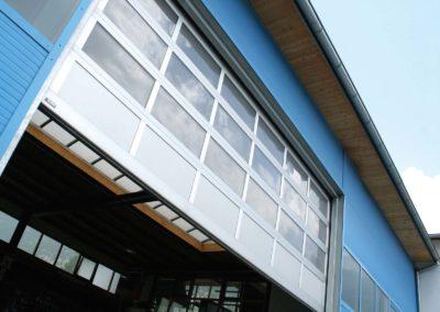 1 - Portone sezionale vetrato LUXOR - Ossidato naturale con tamponamento - 04 (2)