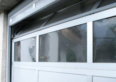 1 - Portone sezionale vetrato LUXOR - Ossidato naturale con tamponamento - 04 (22)
