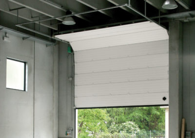 Portone sezionale industriale DOCK - Stucco bianco C21 vista interna - 01
